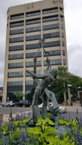 La Crosse statue by its tallest building