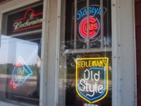 The Wooden Nickel, almost within sight of Illinois, features Wrigley Field's beers. These signs change dramatically as you continue north on Highway 32.