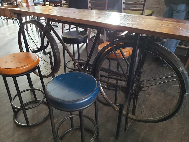Some bike art holds up a table at Shipwrecked Brewpub in Egg Harbor