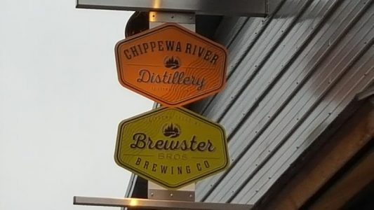Chippewa River Distillery and Brewster Brothers Brewing sign