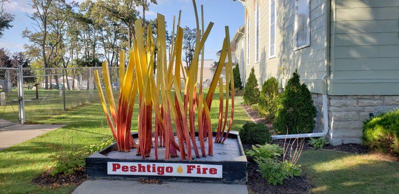 Peshtigo Fire sculpture outside the Museum