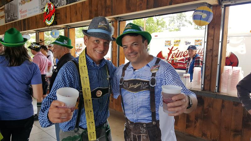 State Trunk Tour's Eric Paulsen with Dick Leinenkugel of the namesake brewery, toasting Chippewa Falls Oktoberfest.