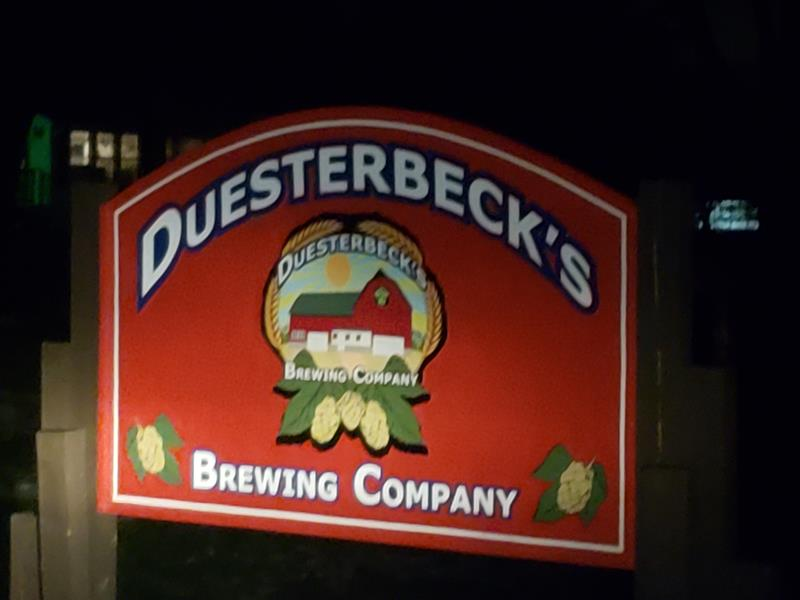 Duesterbeck's Brewing sign at night along County O