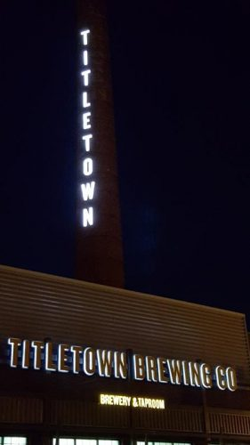Titletown Brewing sign towering above its Beerworks facility in downtown Green Bay, Wisconsin