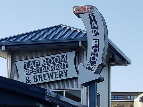 Sign beckoning you into the Tap Room & Restaurant at Fox River Brewery, Oshkosh, Wisconsin