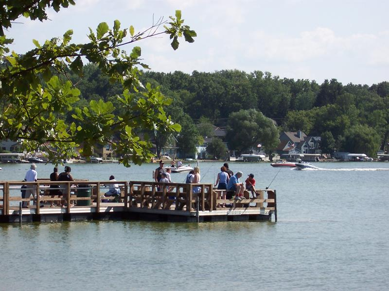 Next To The Beach Across From S And Restaurants A Pier Juts Out Into Pewaukee Lake Plenty Of People Enjoy Fishing On This Particular Summer Day
