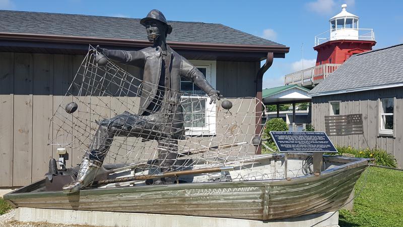 Statue at Historic Rogers Street Fishing Village