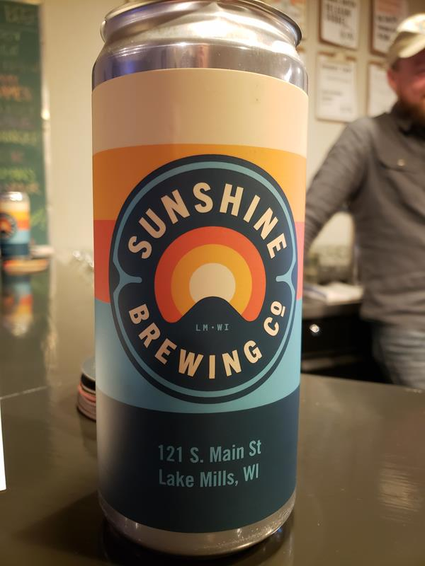 Sunshine Brewing Company can at the bar