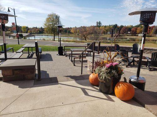 Outdoor patio overlooking Memory Lake at Brickfield Brewing Company, Grantsburg, Wisconsin