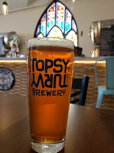 Tap and some stained glass to admire at Topsy Turvy Brewing, Lake Geneva, Wisconsin