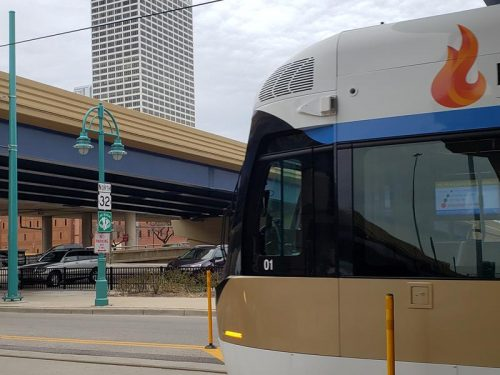Highway 32, Wisconsin's tallest building, and The Hop streetcar all in one shot in downtown Milwaukee, between the eastbound and westbound bridges of I-794.