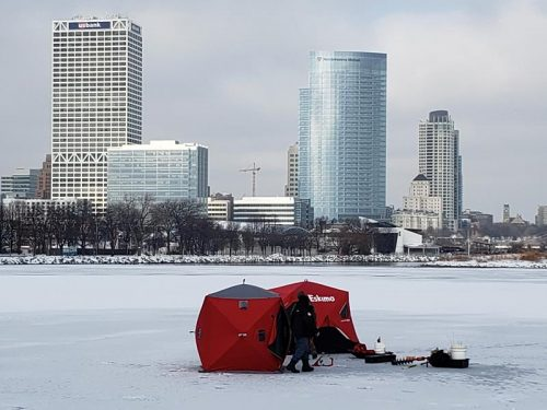 Ice Fishing in the lagoon in Lakeshore State Park, Milwaukee, Wisconsin