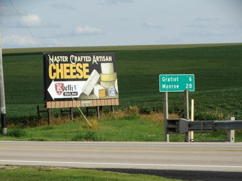 Signs guide you to Roelli Cheese Haus along Highway 11 near Shullsburg and the intersection with Highway 23