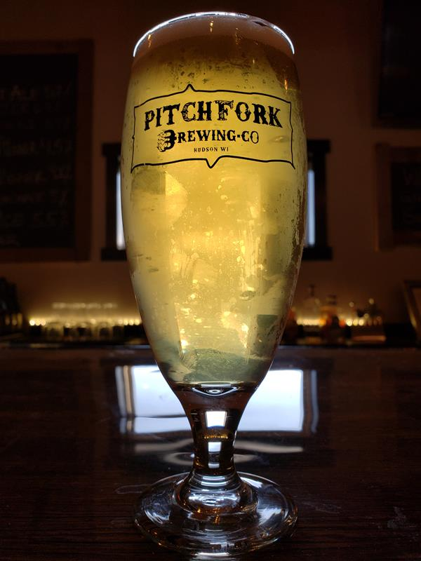 A shiny pint of Dry Hopped Pilsner at Pitchfork Brewing just off I-94 and U.S. 12 in Hudson, Wisconsin